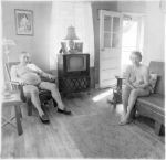 Retired man and his wife at home in a nudist camp one morning  N.J. 1963